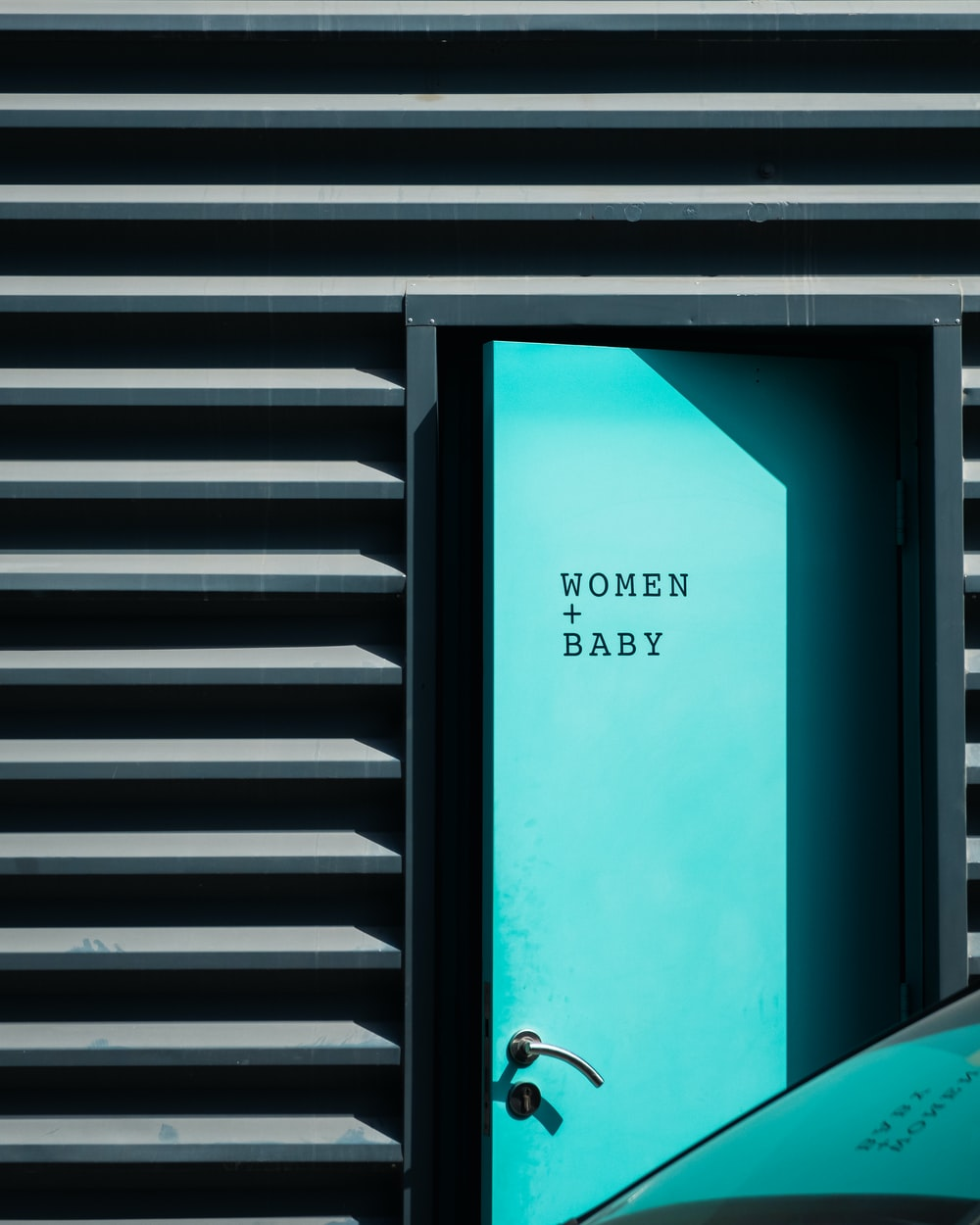 open teal door