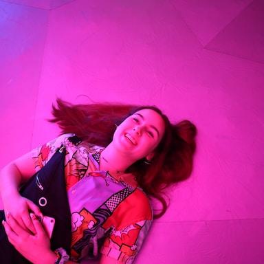 woman lies on pink floor