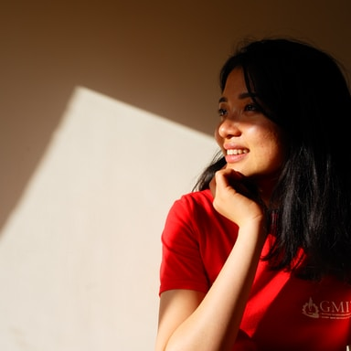 shallow focus photo of woman in red T-shirt