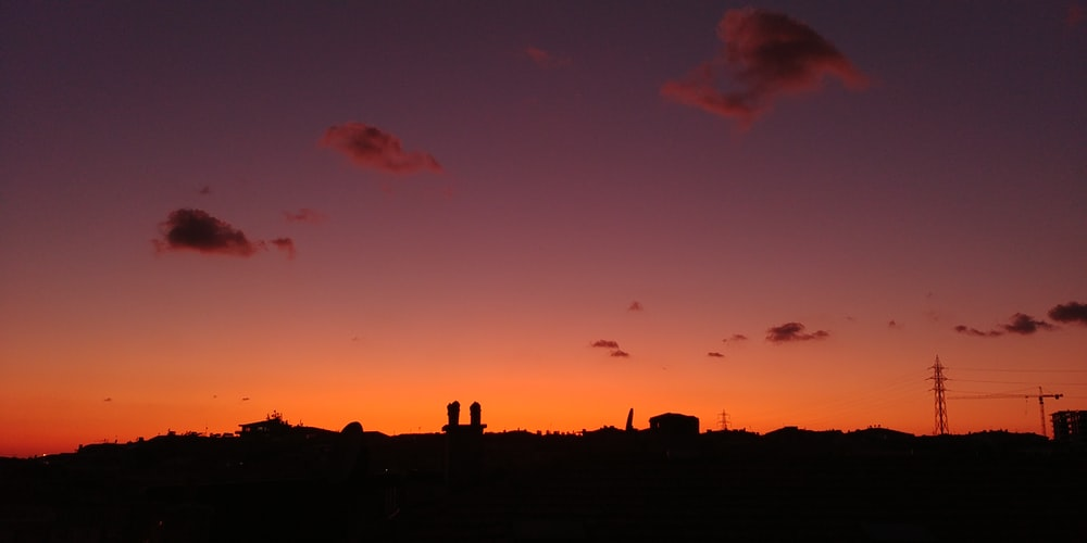 silhouette of houses during golden hour