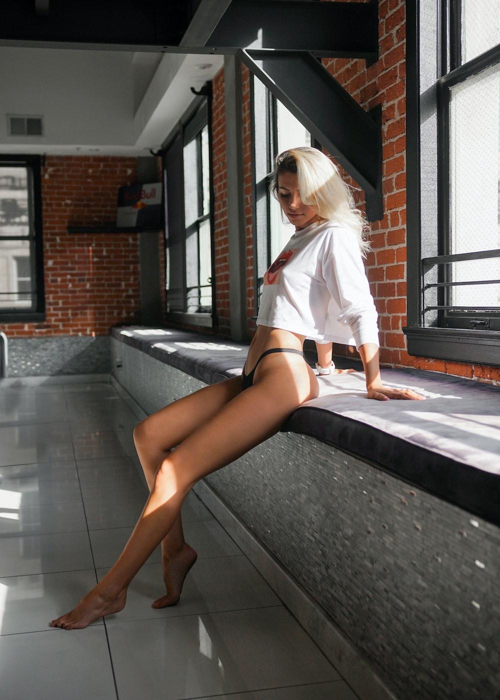 woman sitting near window