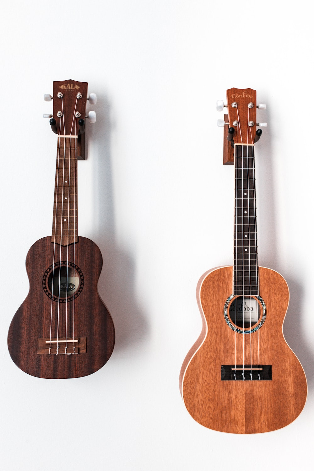 two brown acoustic guitars