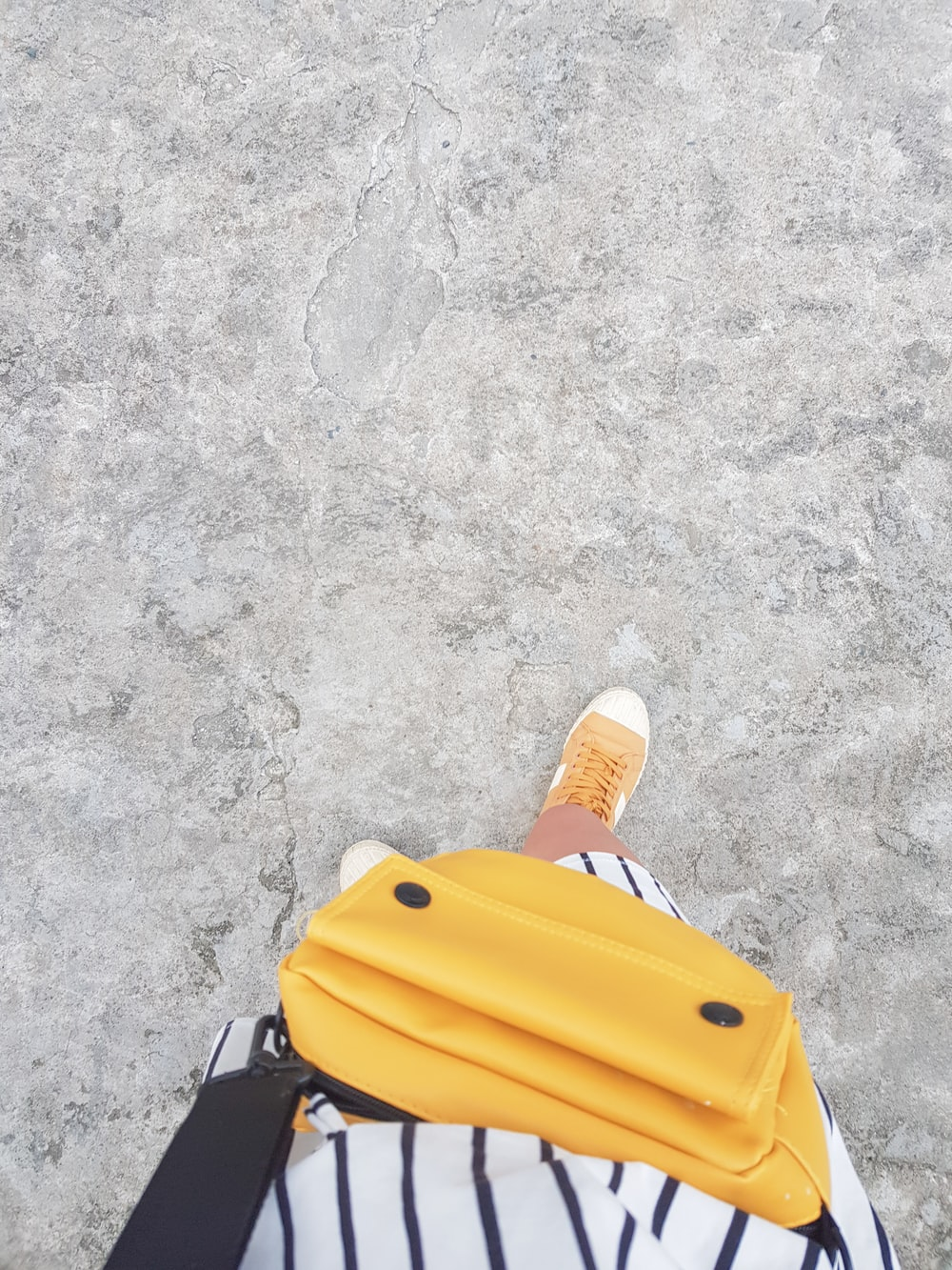 person with yellow bag