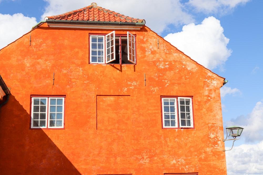 orange building with opened windows