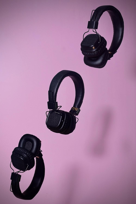 three black cordless headphones
