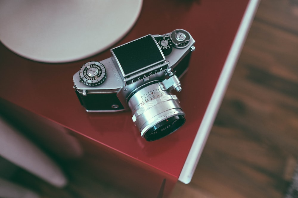 gray camera on red surface