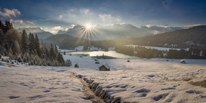 Fresh snow at the lake Geroldsee, while the sun is above the Karwendel