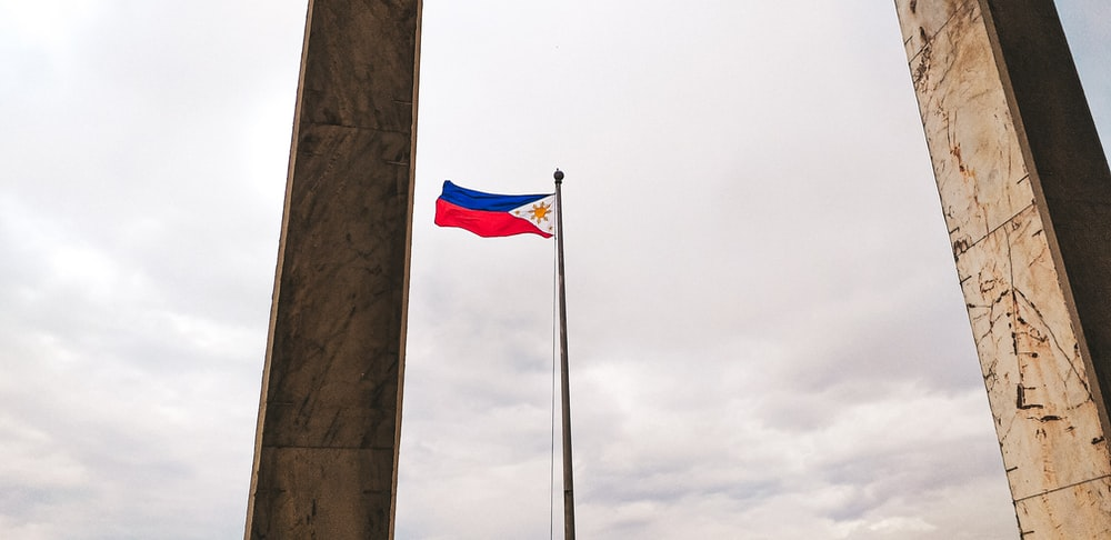 rising flag of Philippines during daytime