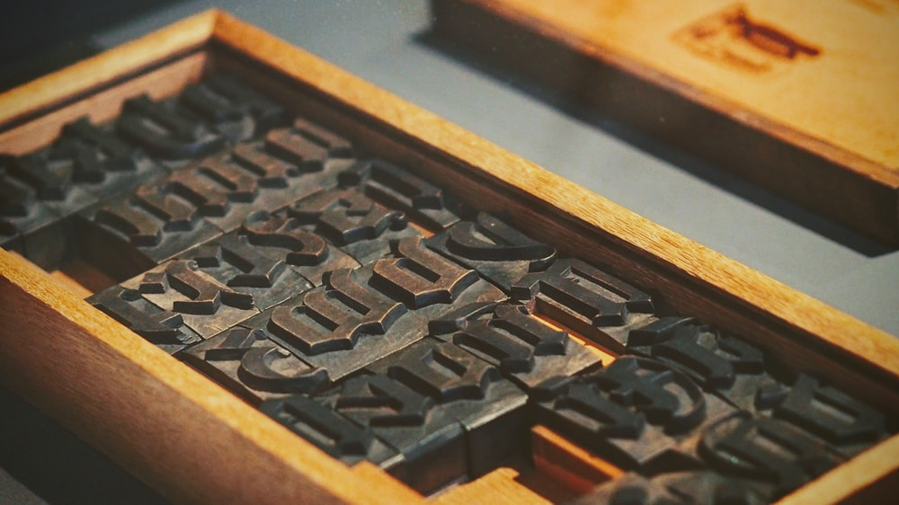 metal stamp set inside wooden case