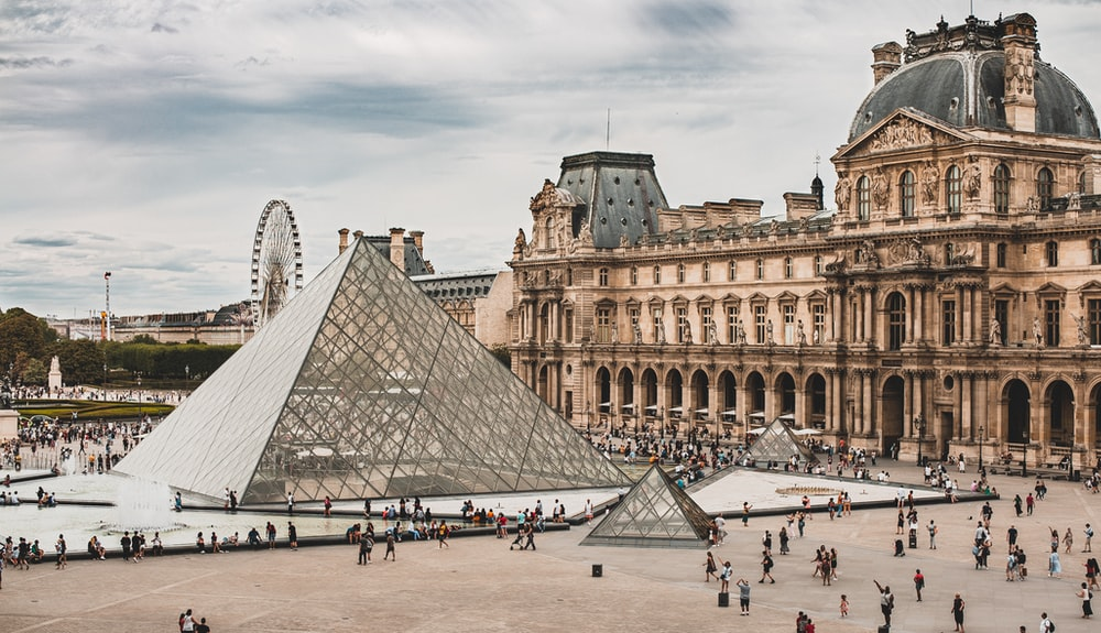 people gathering near Louvre Museum during daytime