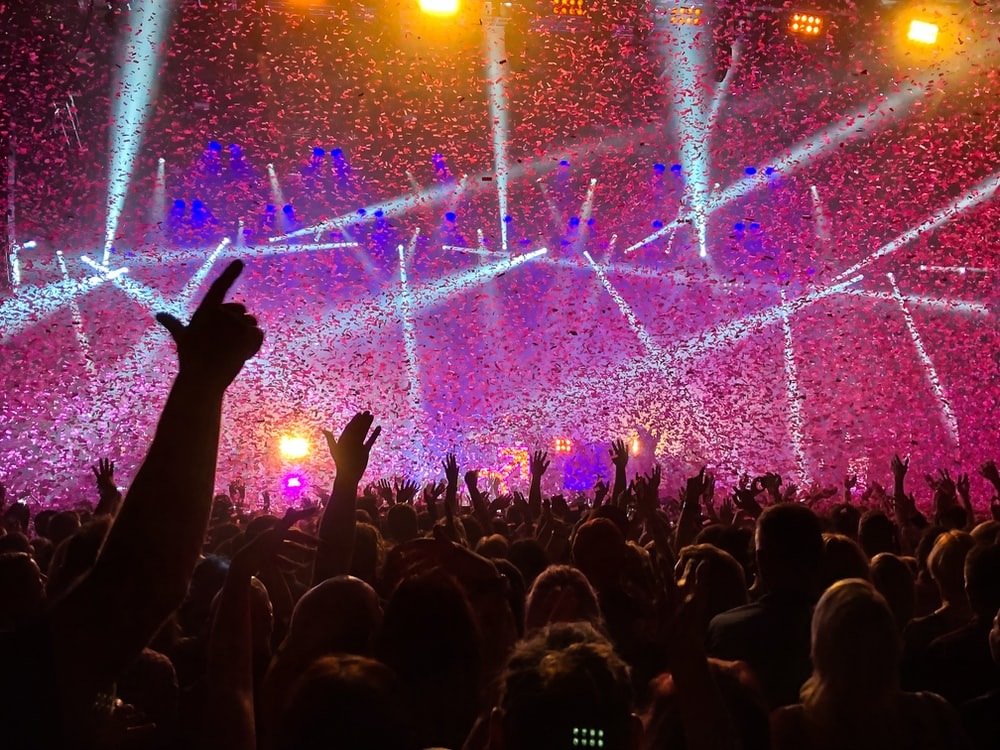 crowd raising their hands