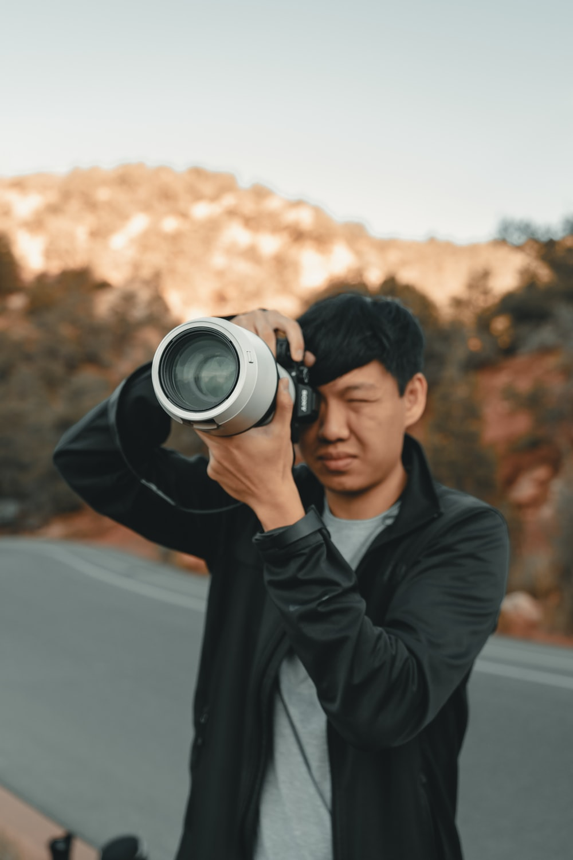 man pointing camera
