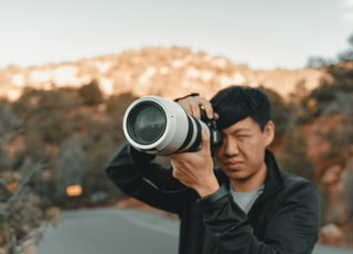 white and black DSLR camera