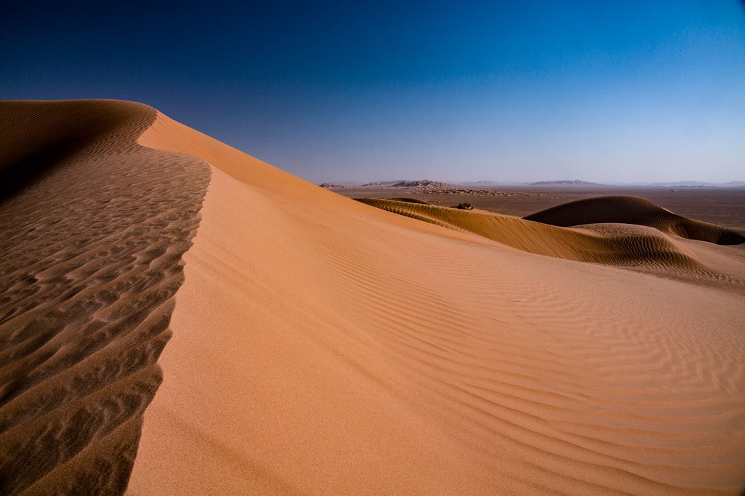 ing up the sand dunes in Rub al-Khali, Oman.