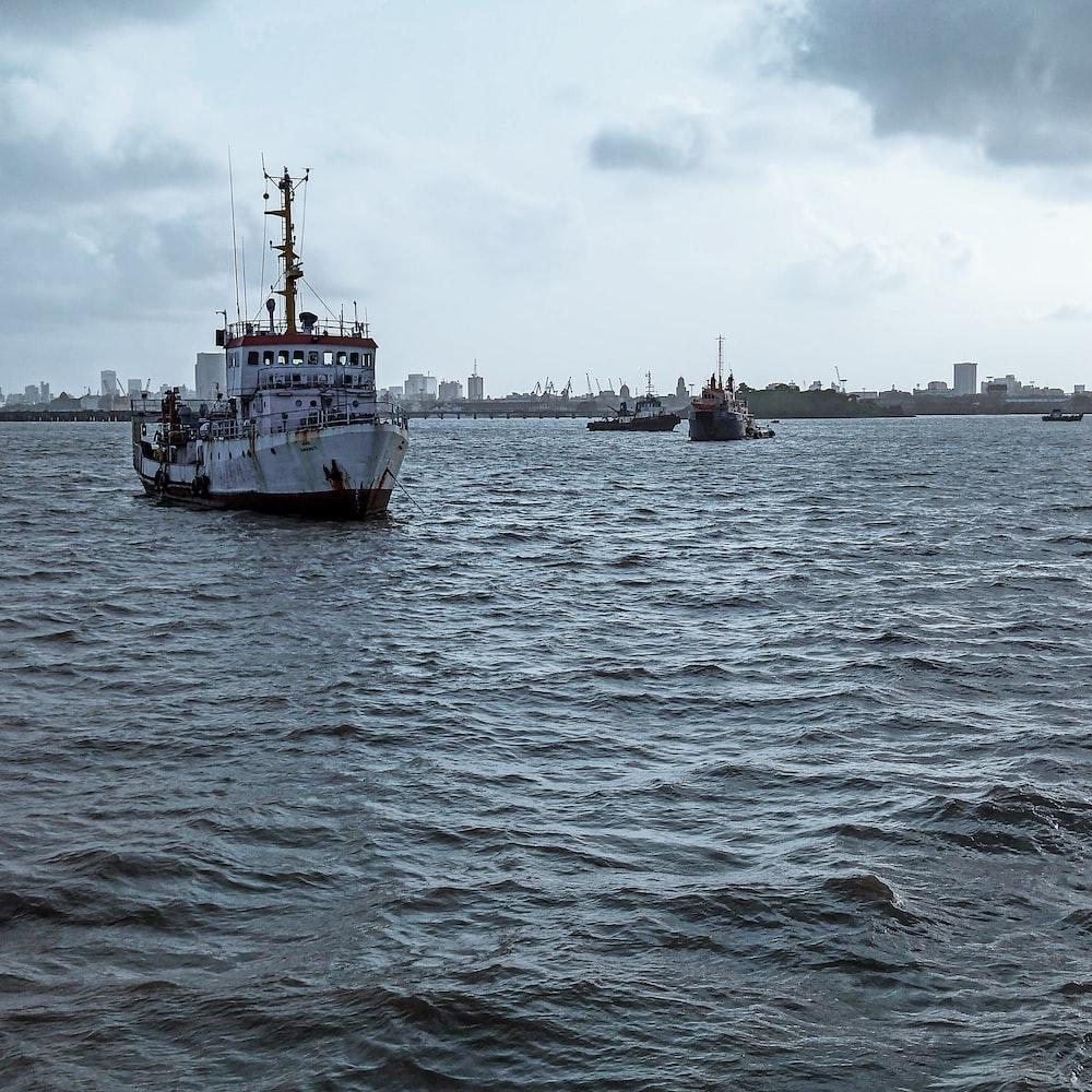 white ship on sea at daytime