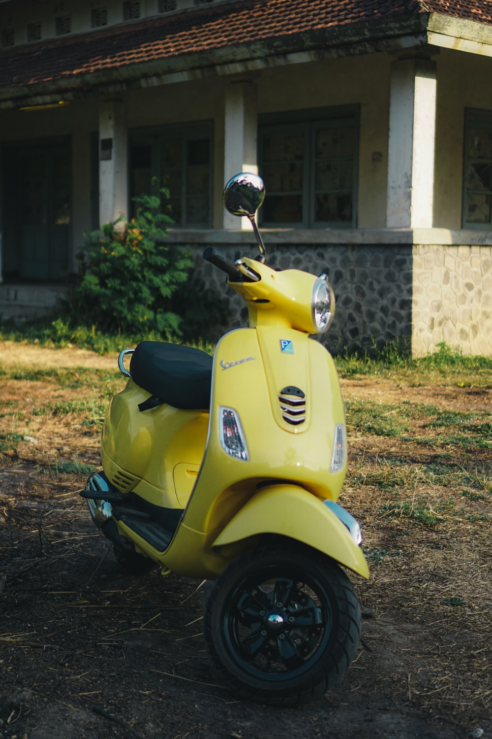 yellow motor scooter during daytime