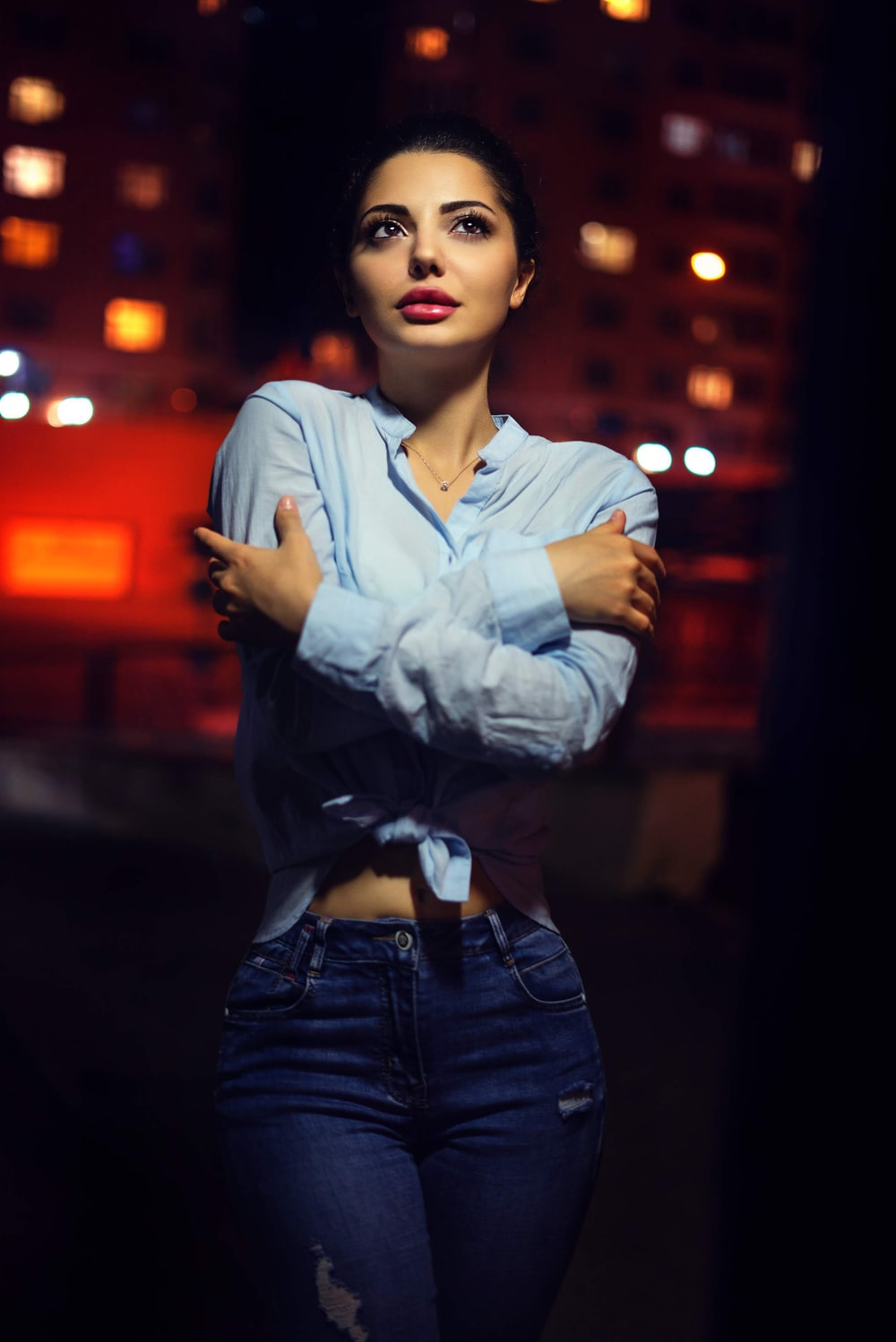 woman wearing blue collared button-up long-sleeved shirt standing