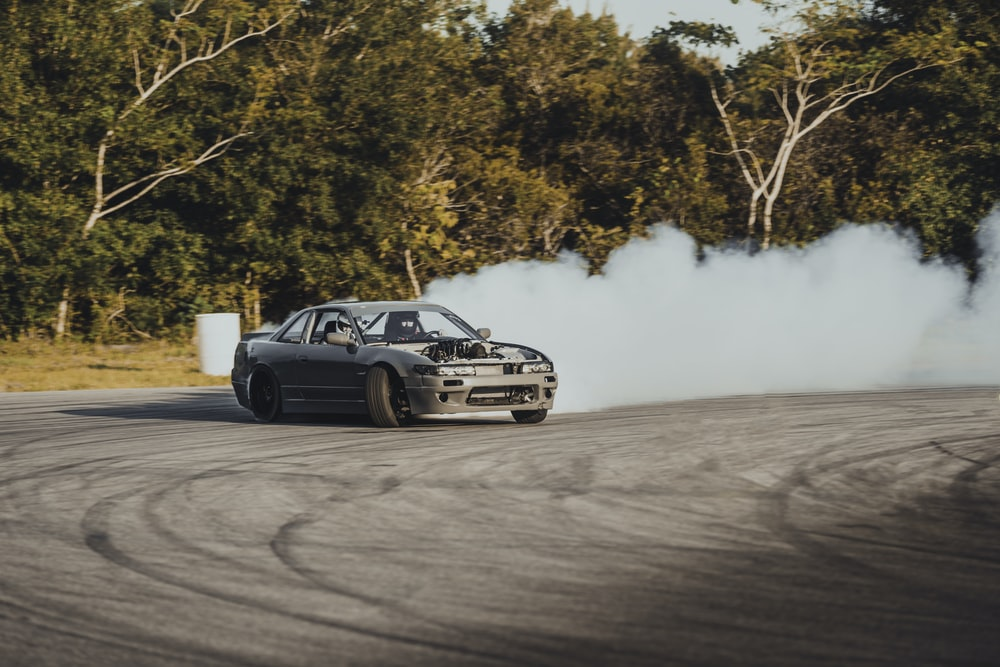 time-lapse photography of a drifting car