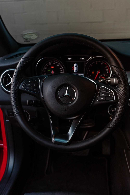 shallow focus photo of black Mercedes Benz steering wheel
