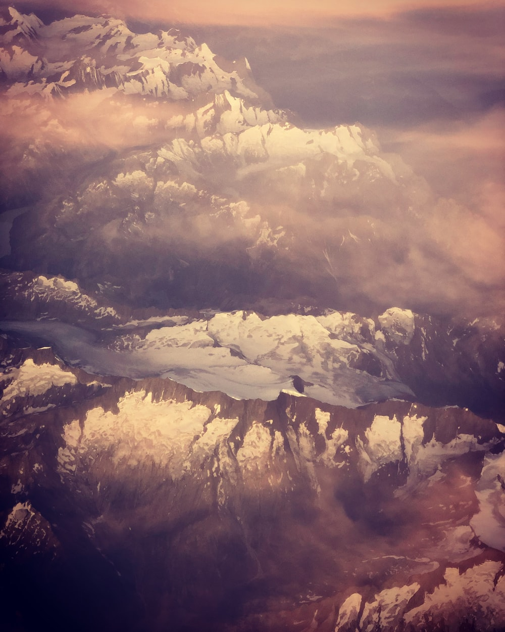 aerial photography of snow-capped mountain range during daytime