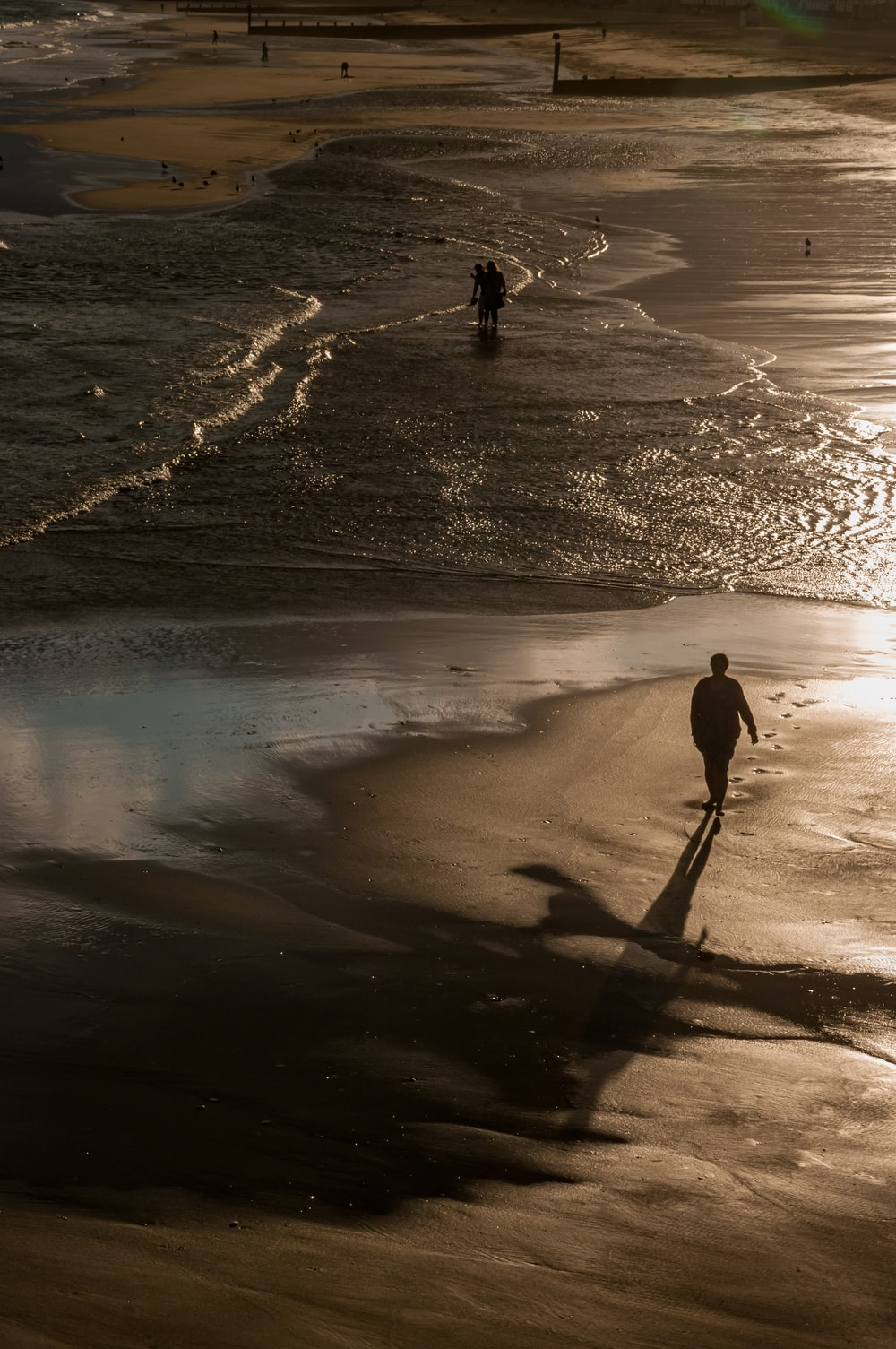 person standing on seashore during daytime \