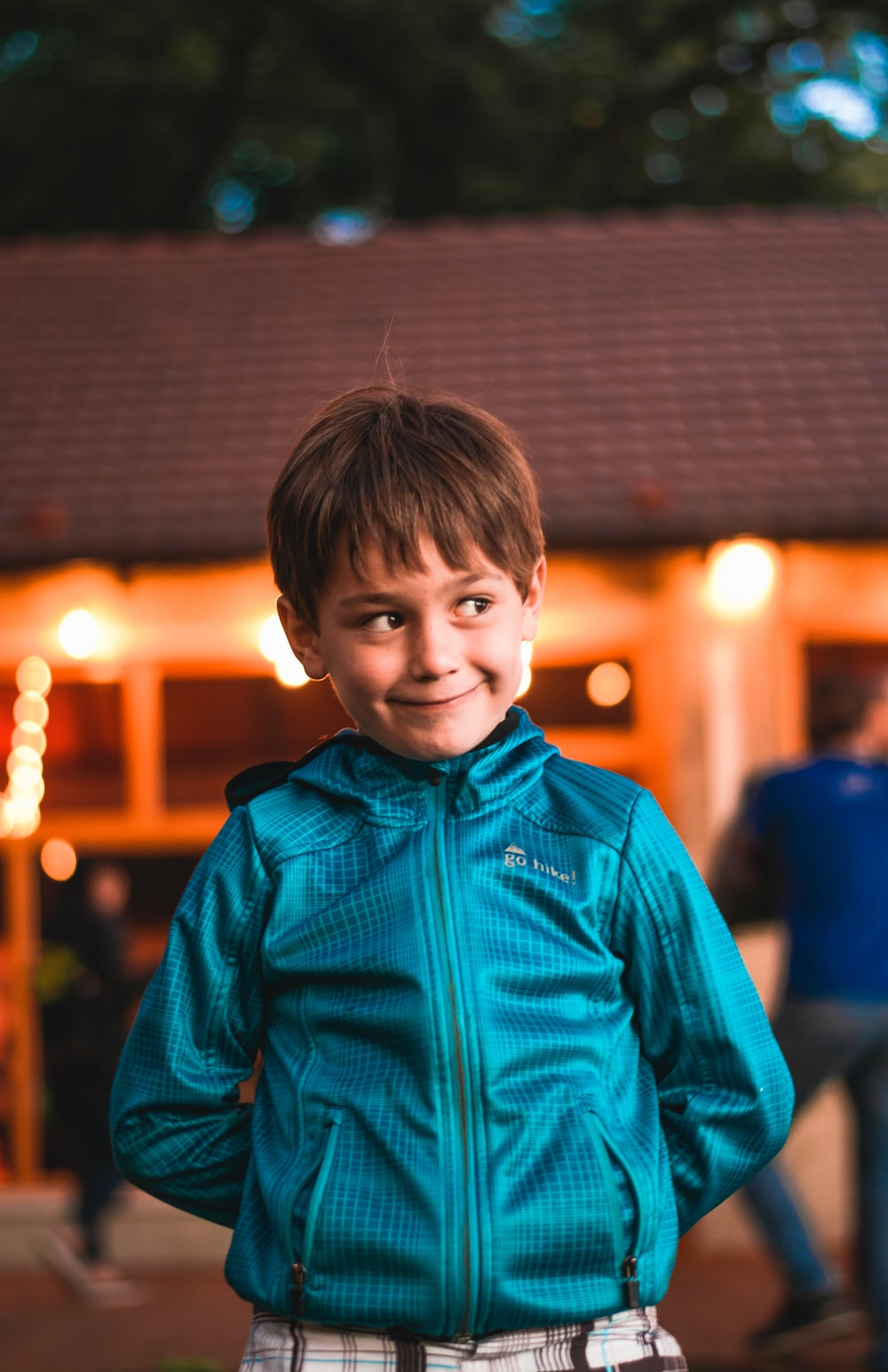 boy wearing blue full-zip hoodie jacket