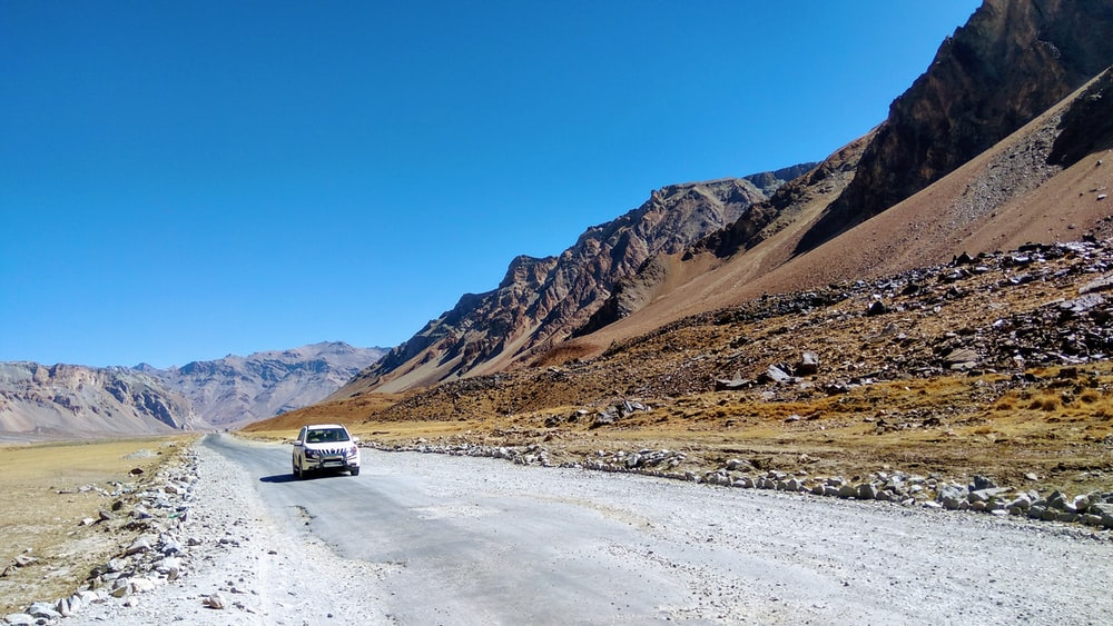 white vehicle on road