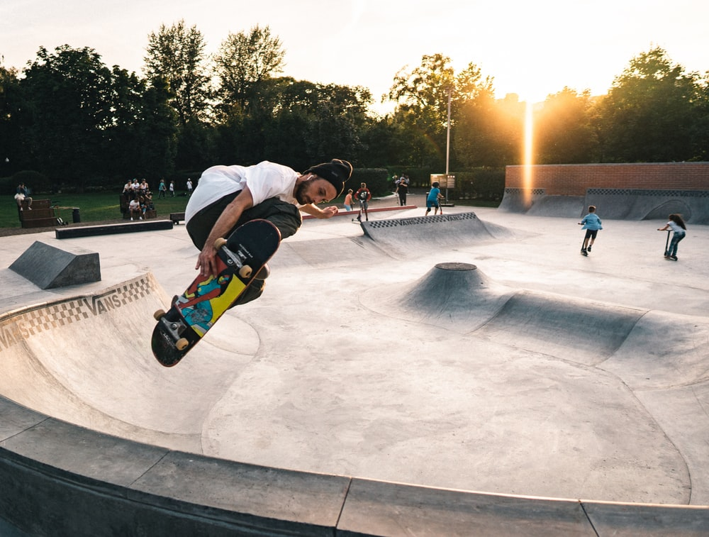 person skateboarding on gray concrete ramps