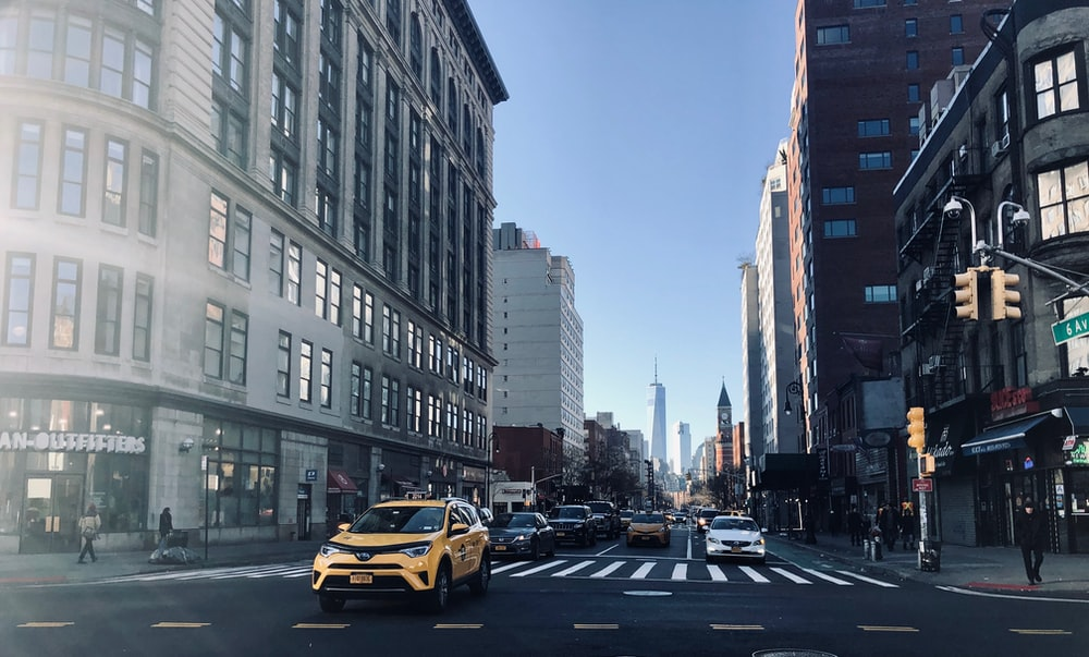 yellow SUV on road