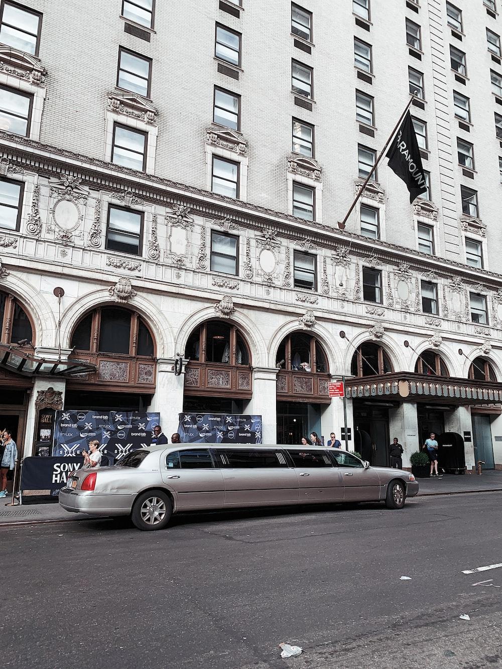 silver limousine near hotel