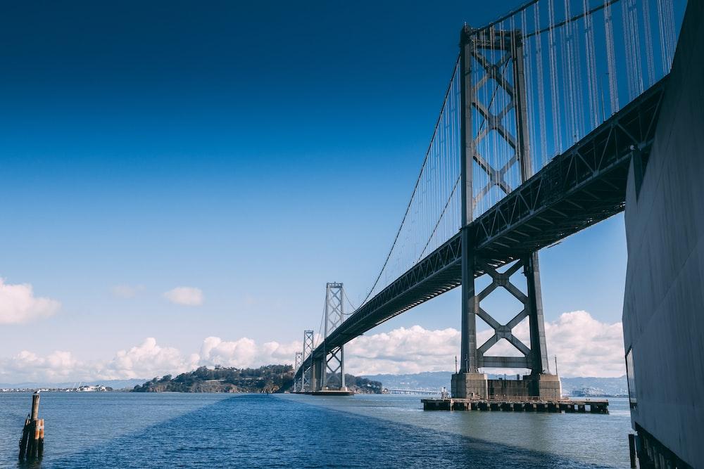 gray steel bridge under clear blue sky