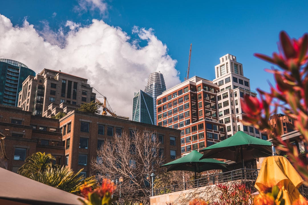 The always-under-construction nature of Soma in San Francisco. This shot towards Salesforce Tower was taken from a restaurant on the water at the Embarcadero. This area's name is often confusing because it goes by so many: East Soma, Rincon Hill, Embarcadero. Call it whatever you like :).