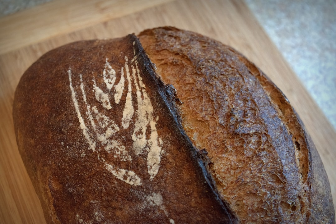 close up of sourdough bread with flour wheat by Crust and Crumb Co.