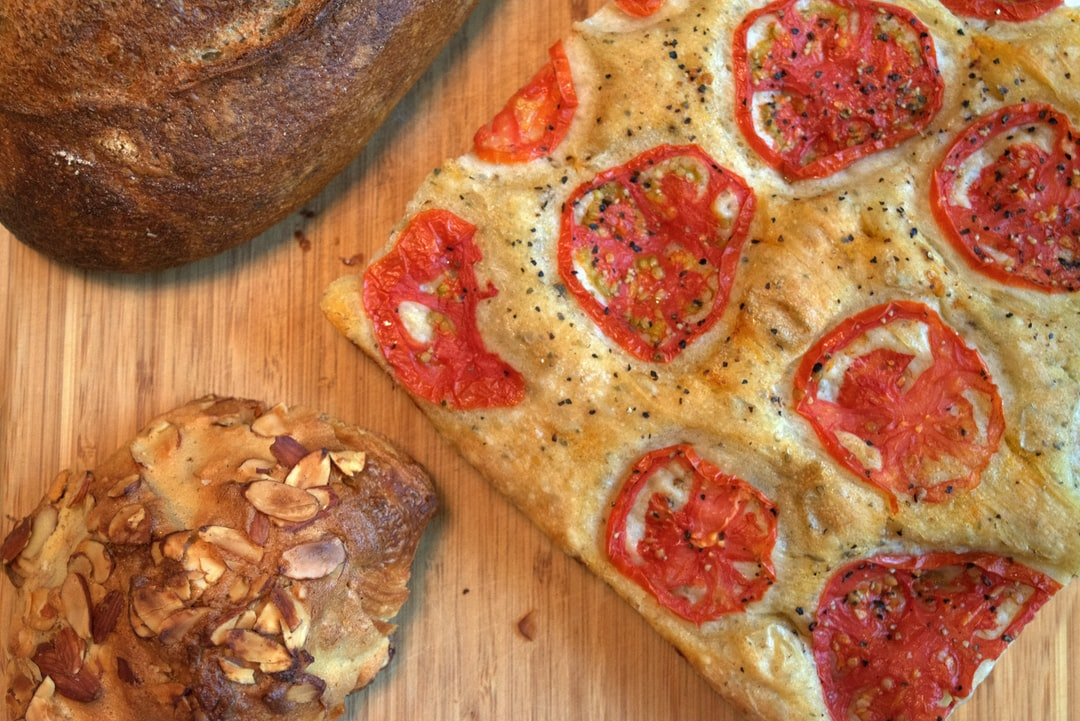 Close up of sourdough bread, focaccia, and almond croissant collage made by Crust and Crumb Co.