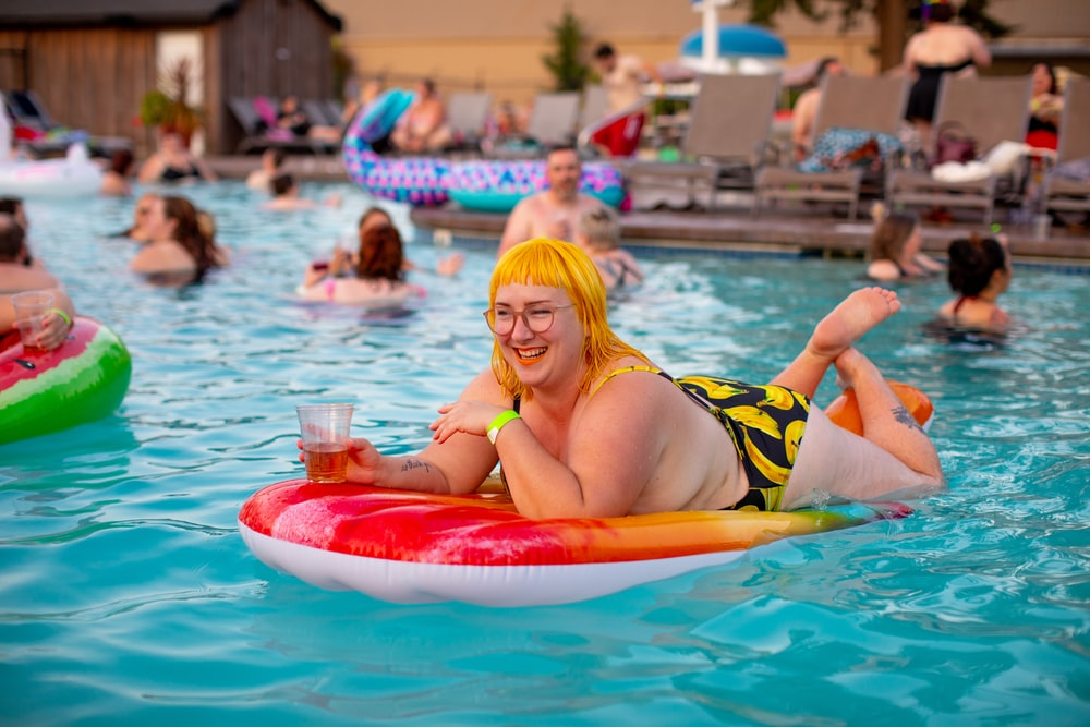 smiling woman on pool float