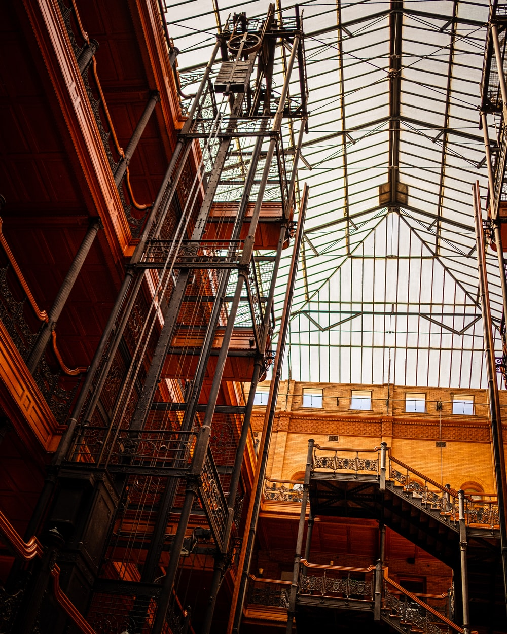 low angle photography of brown building interior with scaffolding