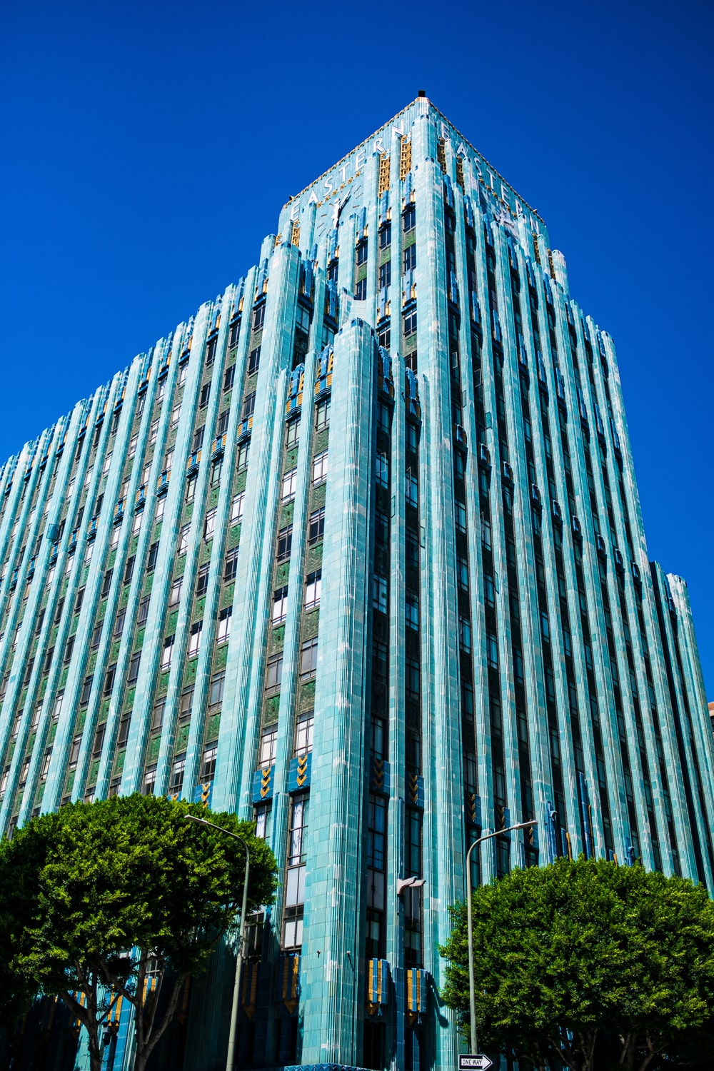 low angle photography of gray concrete mid-rise building during daytime