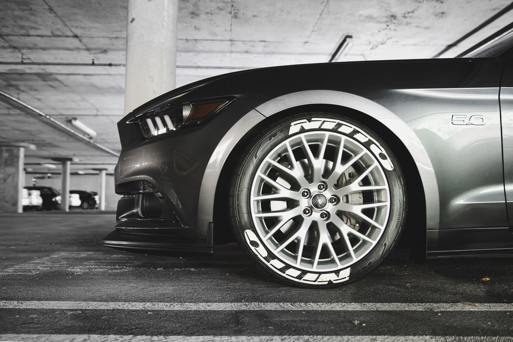 grayscale photography of parked vehicle