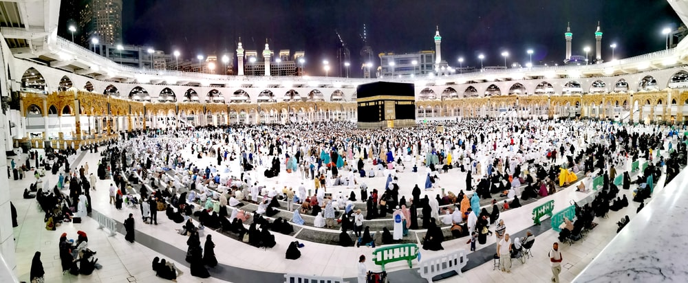 people gather inside Kaaba Mecca