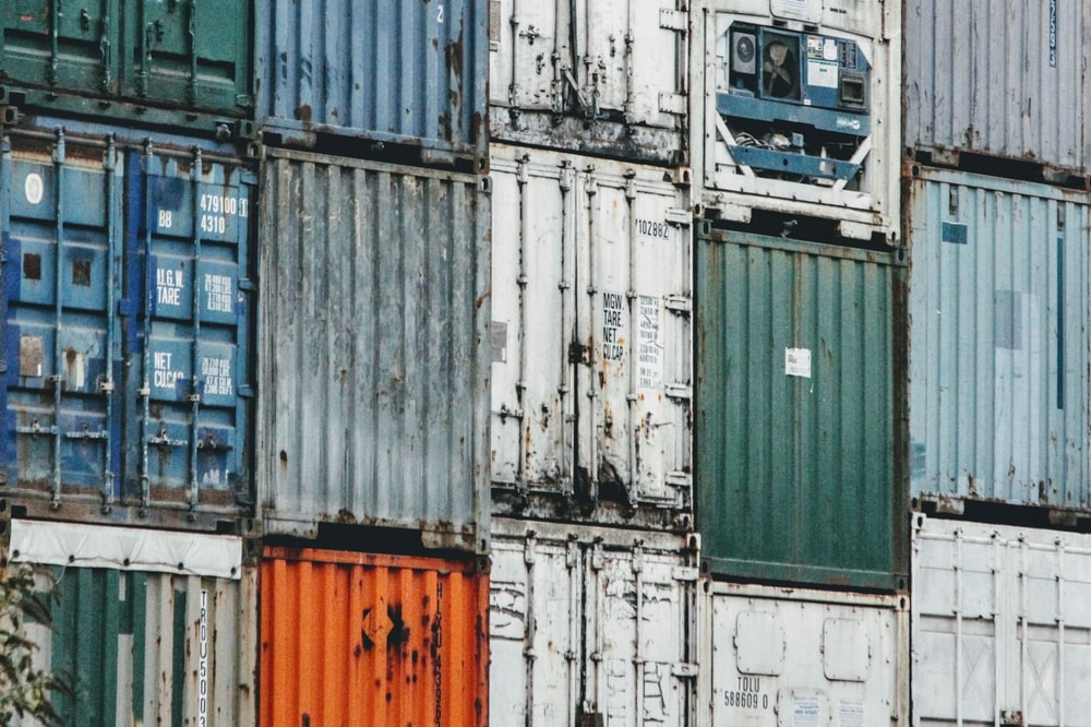 assorted-color shipping container during daytime