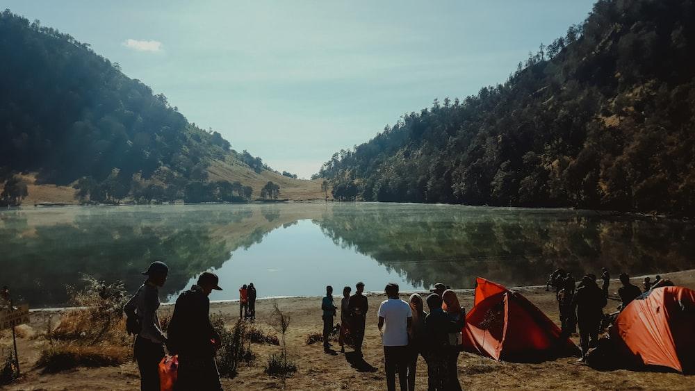 people camping near lake