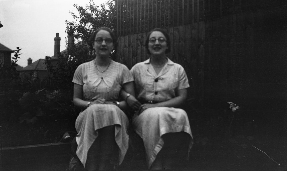 two women sitting beside each other