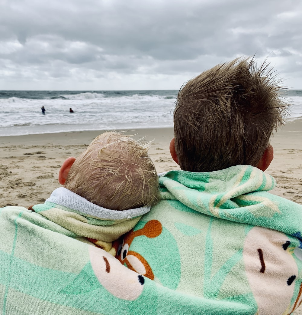 two boys sitting on seahote