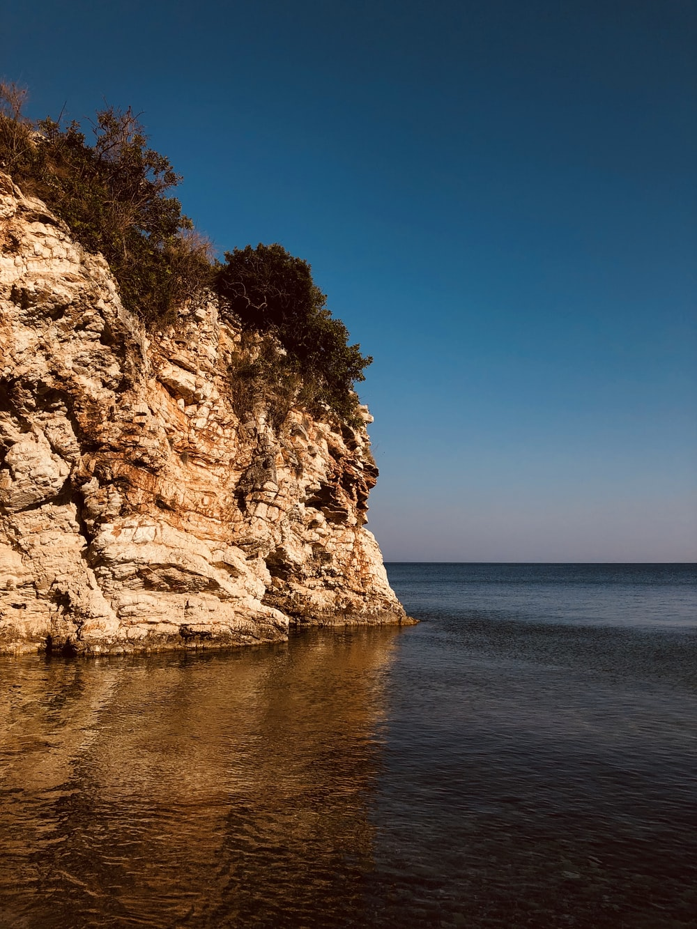 mountain cliff fronting the sea