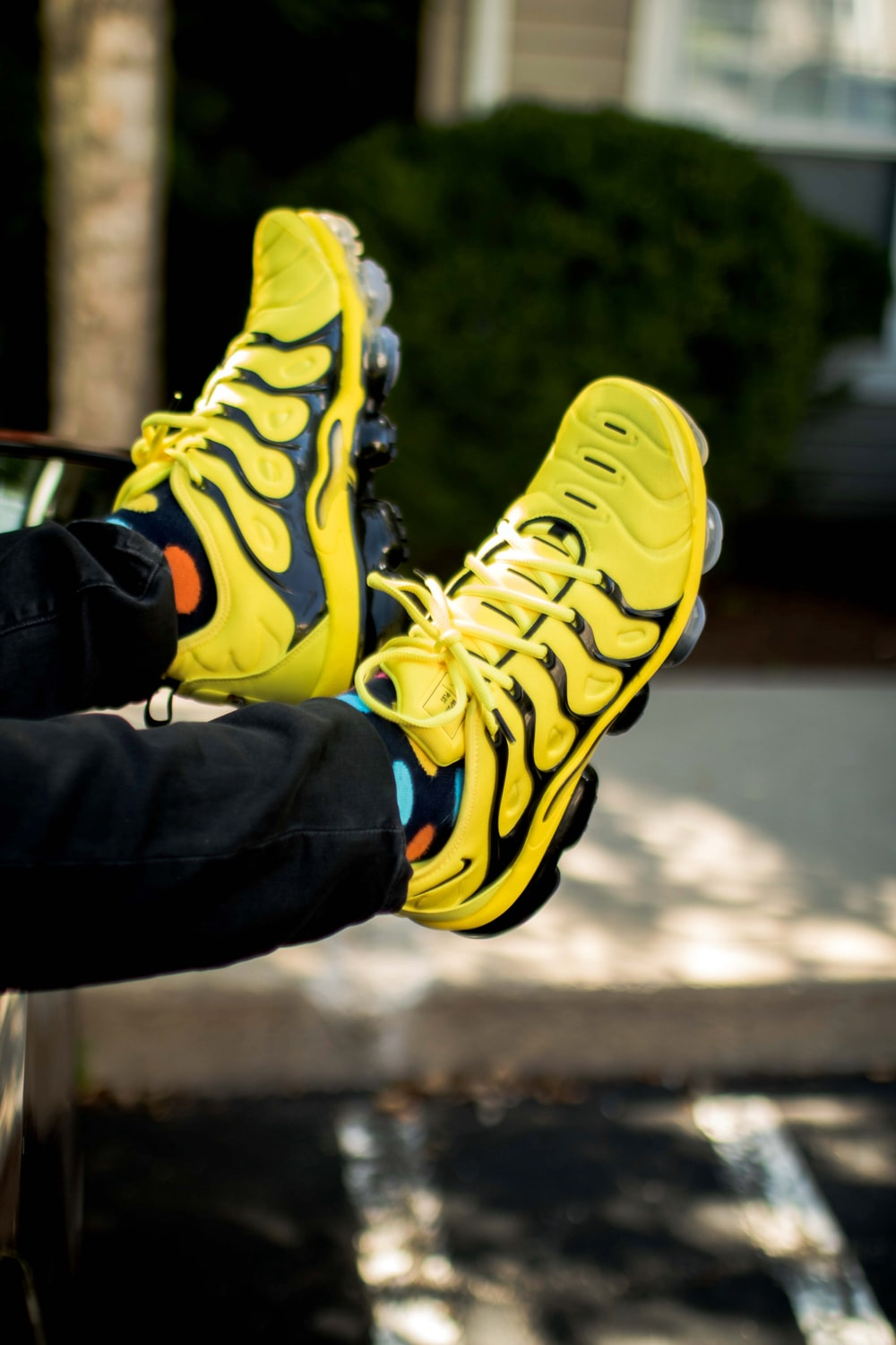 person wearing yellow-and-black Nike basketball shoes