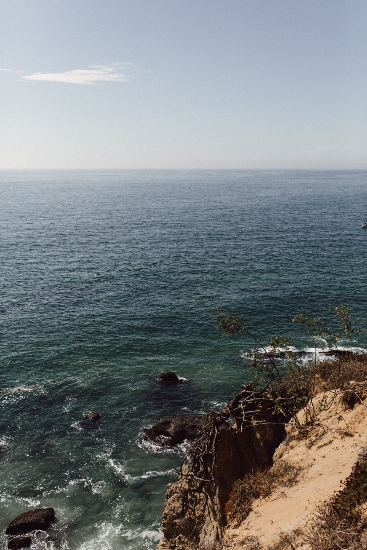 waves crashing on coastal rocks during daytime