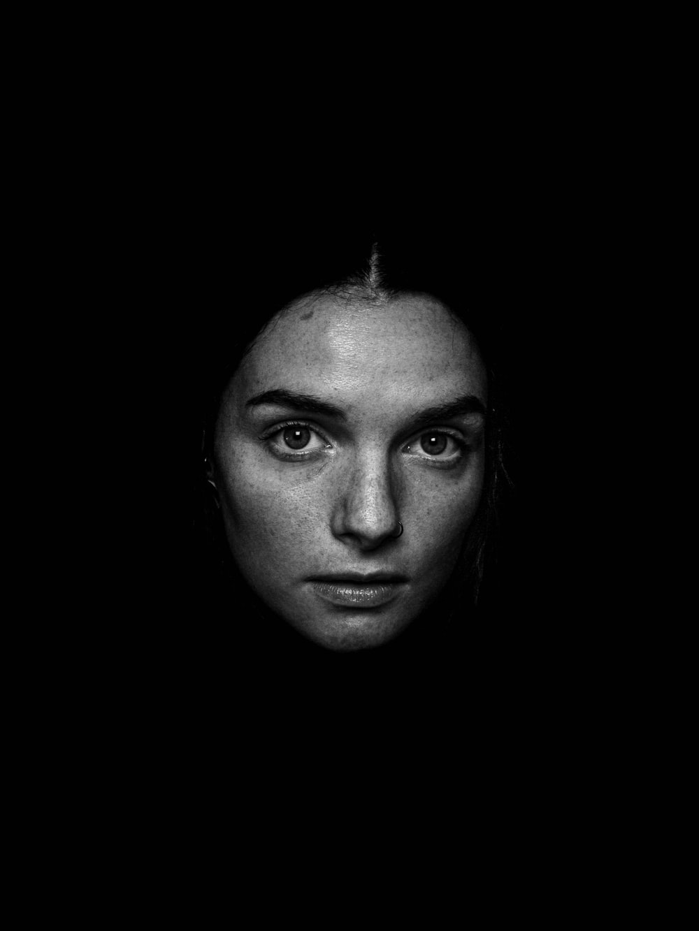 grayscale photography of woman looking straight