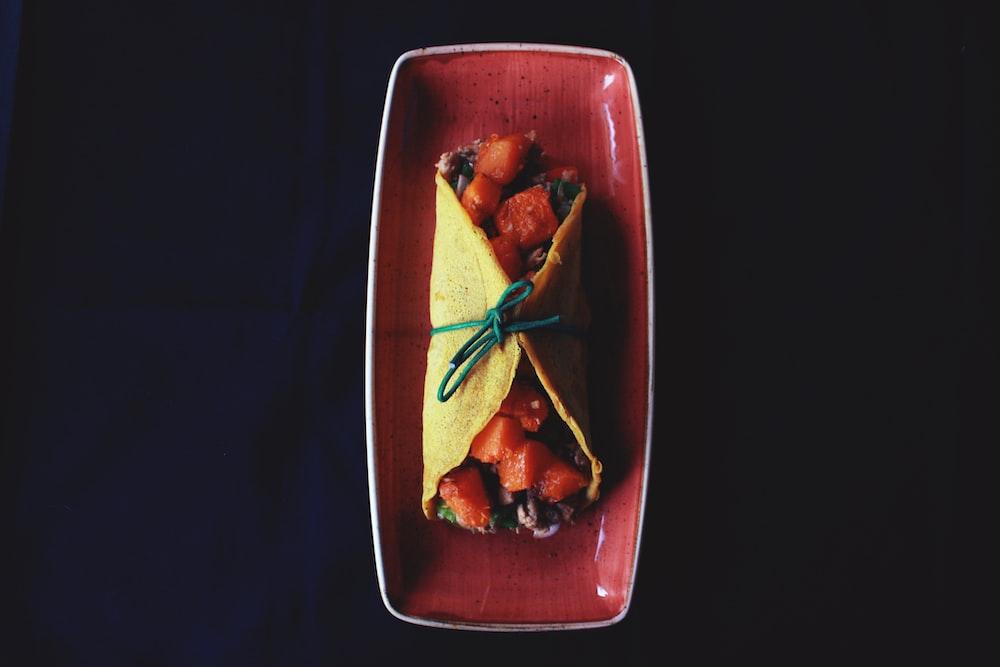 taco on maroon ceramic tray