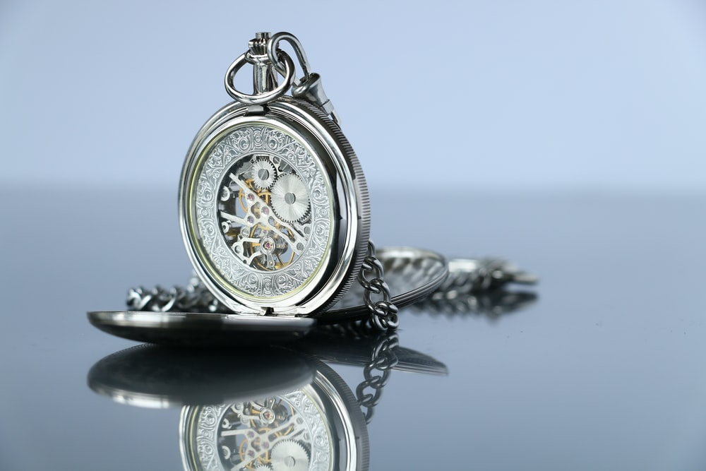 silver-colored pocketwatch