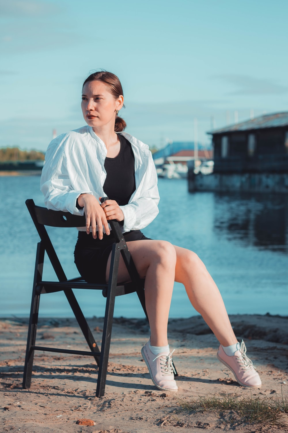 woman sitting on chair near water